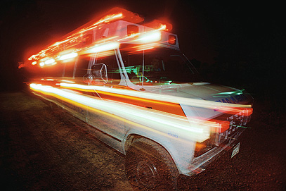 Speeding Ambulance at night